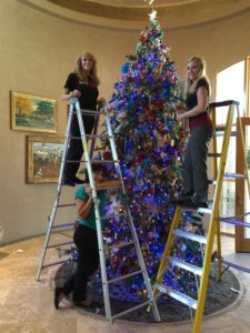 Paige's Team Decorating Christmas Tree